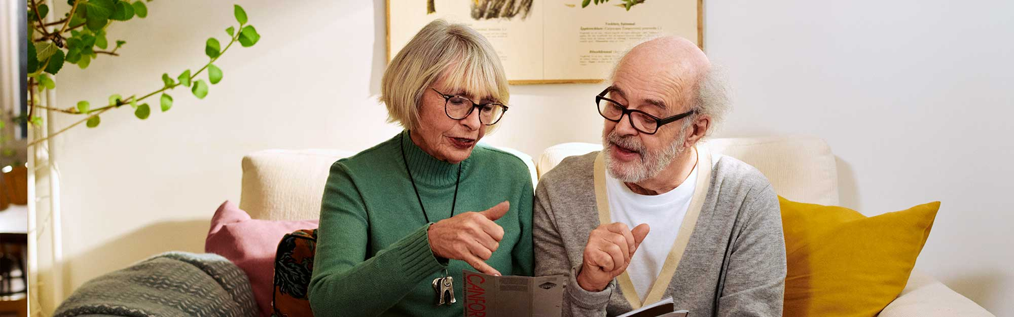 Senior couple looking in a book together